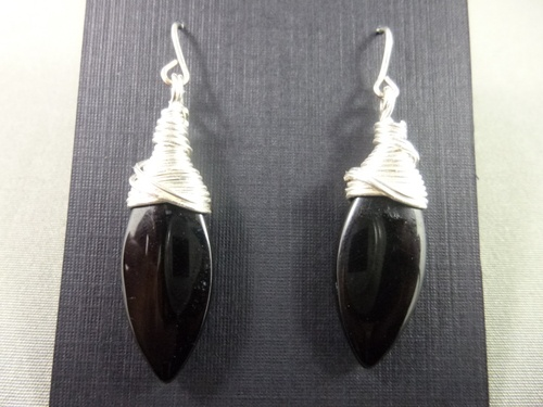 Black glass drops wrapped with a non-tarnish silver wire and sterling silver earwires.