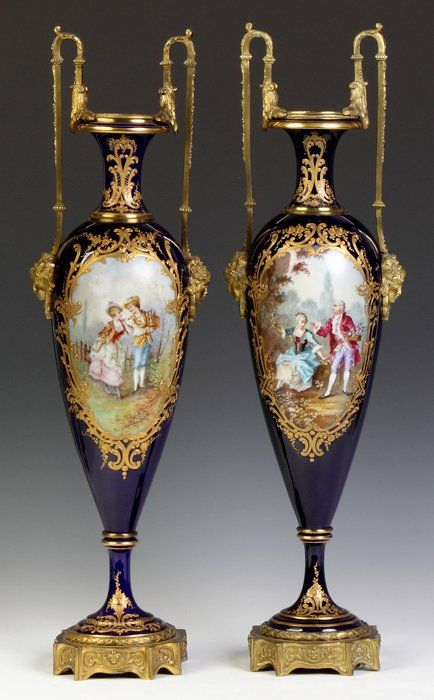Pair of Sevres Porcelain And Gilt Bronze Urns With Hand Painted Scenes - Artist Signed   c. 19th Century
