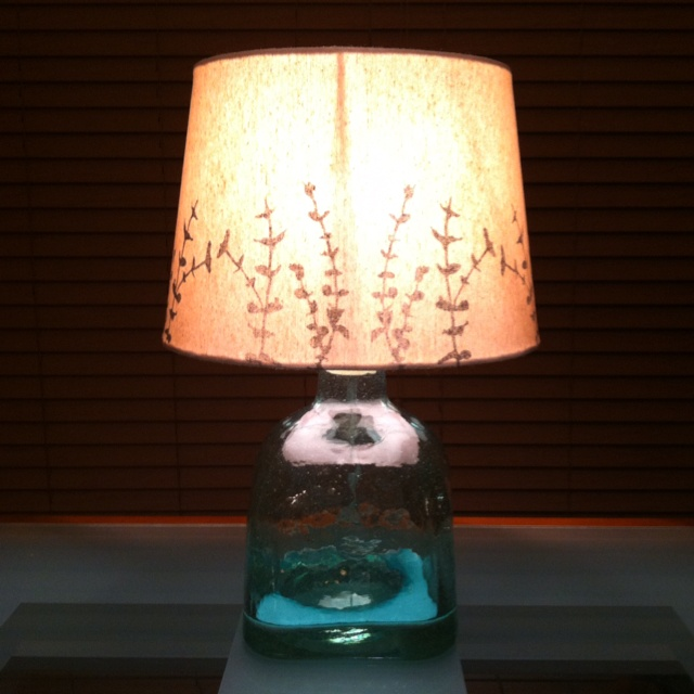 "Lamp I made from a bottle of Patron! I drilled a hole in the back to feed the cord through, and used a basic lamp kit from Lowes. I ""dyed"" the glass green using blue and green food coloring and Mod Podge."