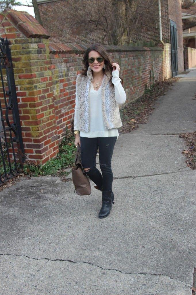 how to wear black and white for the winter; Belk Faux Fur Vest, J. Crew Boyfriend Sweater, Old Navy Jeans, Madewell Moto Boots, Anthropologie Earrings-- on www.glitterandgingham.com