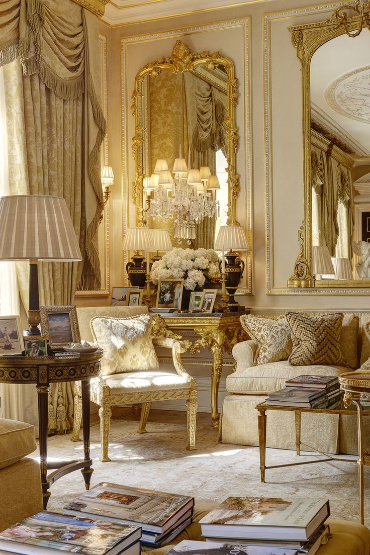 The Interior Is Sophisticated And Extravagant The Leaf Framed Mirror Pompous Chandelier And Gold Drooping Curtains Highlight The Traditional French Decor
