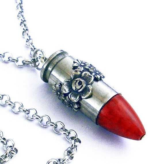 Reminds me of an old lipstick... This one is lovely with silver roses on a nickel casing, and a red stone tip. This pendant is made from a spent shell casing. It is completely harmless... no explosives left... youll have to supply your own sparks.  The casing with tip is approx. 1 1/4 inches in length and hangs from an approx. 24 inch chain with lobster claw clasp.   To see all of my bullets, click here: http://www.etsy.com/shop/TrashAndTrinkets?section_id=611012...