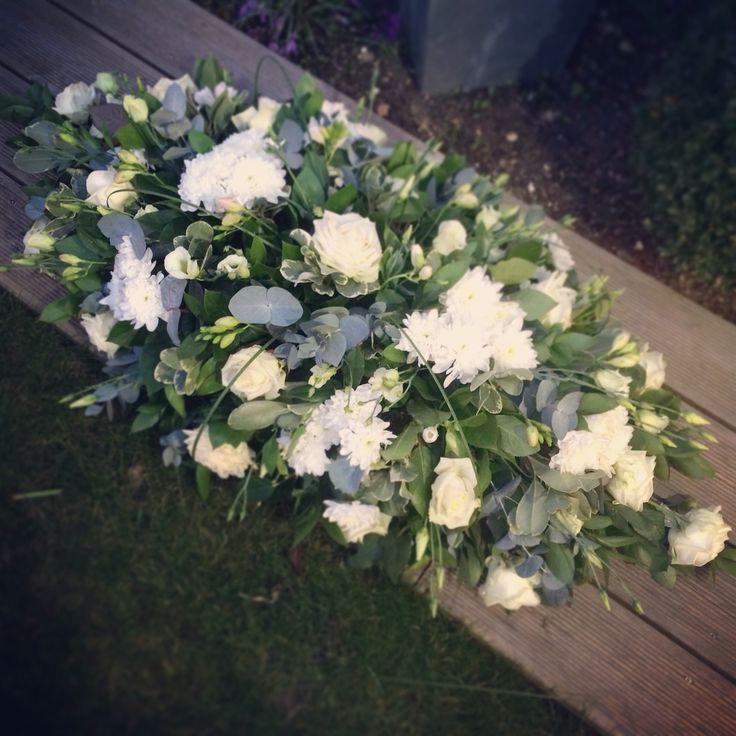Funeral coffin spray- Roses, Chrysanthemums, Eustoma, Freesias,