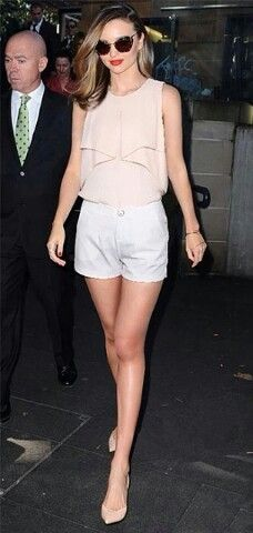 Miranda kerr street style june 2014 - nude blouse, white dressy shorts and nude pumps-summer outfit