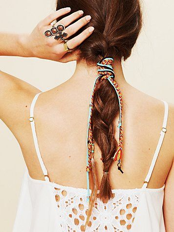 Using a patterned ribbon to tie back your hair is both fashionable and practical - Great tip via @Cristophe Circle!