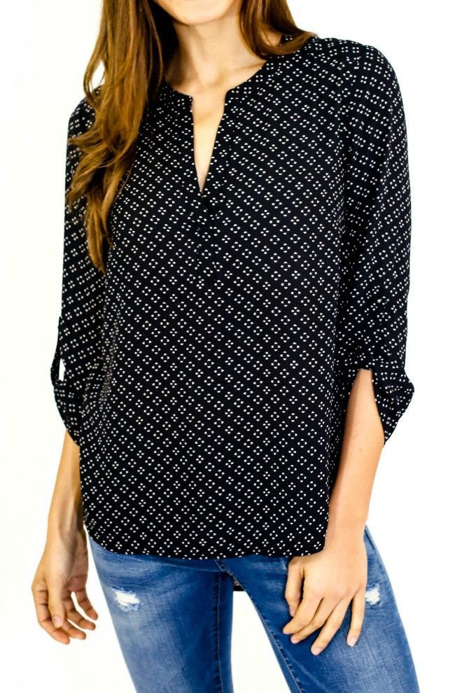Pullover, diamond print, 3/4 sleeve top with roll tab details at sleeves. Style Tip: This is the perfect day to night top! Wear with jeans and flats during the day. Switch to heels and add a leather j