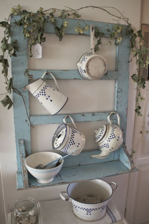 love the blue repurposed frame, but I've never seen enamelware with blue checks before. Beautiful.
