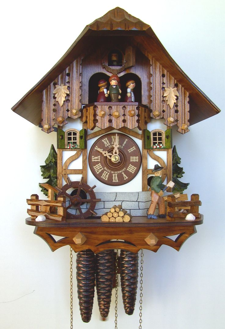 Wooden dial, hands and numerals Shut-off lever for strike, call and music Wooden cuckoo Hand-crafted and hand-painted Solid wood (brown) dancing figurines Plays 2 melodies, 22 notes Moving Woodchopper Music on the half and full hour Official Black Forest Clock certified by the VDS