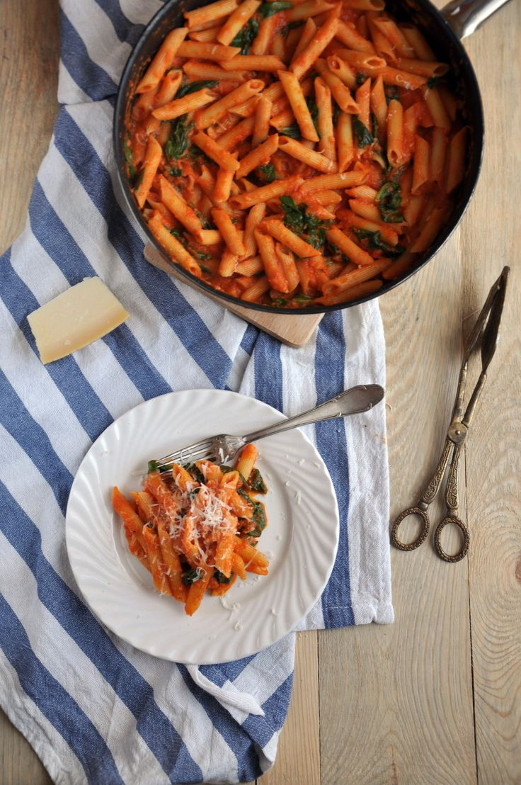 Penne with spinach in a creamy tomato sauce