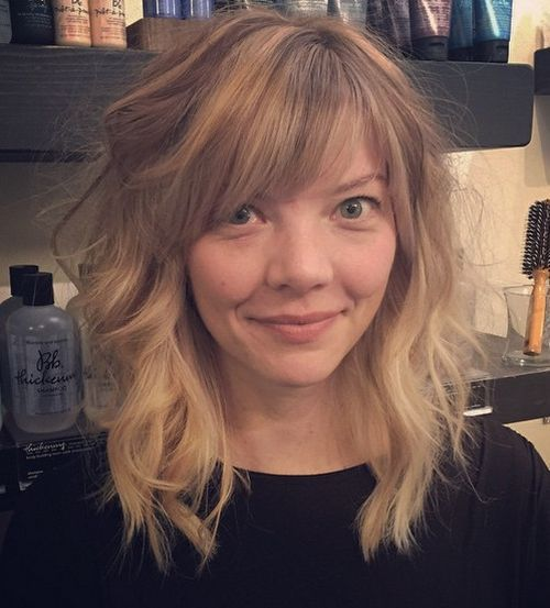 Long Wavy Blonde Hairstyle With Bangs