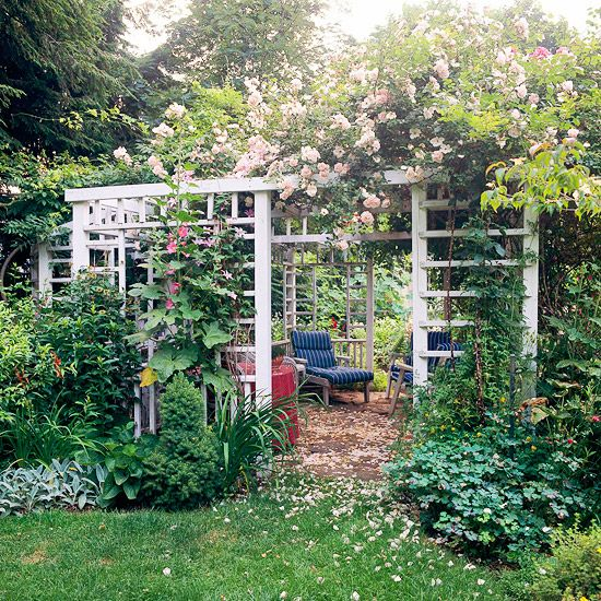 A Roof of Roses  A riotous collection of climbing roses adorns this pretty pergola.  -- If plants aren't intended for a pergola, painted wood poses less of a challenge. But if climbers will grow on and over the structure, consider a material such as composite wood that doesn't require repainting.