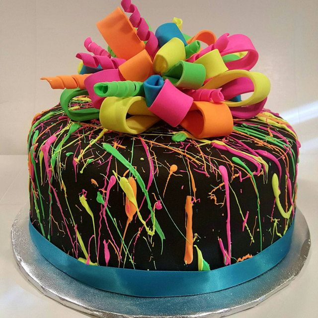 Neon splatter cake, black fondant with white chocolate splatter mixed in with Rolkem Lumo colors I got on @Etsy from ArtsyEdibles. #etsystar http://etsy.me/1SQqgdq #neoncake #neonsplattercake #80scake #neon @nettiescakecreations