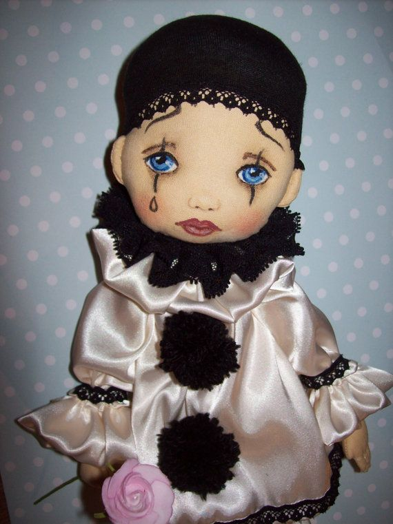 Pierrot textile art doll. The face is by TrixiCreation on Etsy
