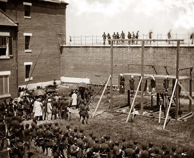 Bodies on Gallows. Seen here are the conspirators Mrs. Surratt, Payne, Herold, Atzerodt in Lincoln's assassination (photographed while still hanging after their execution by hanging on the gallows).