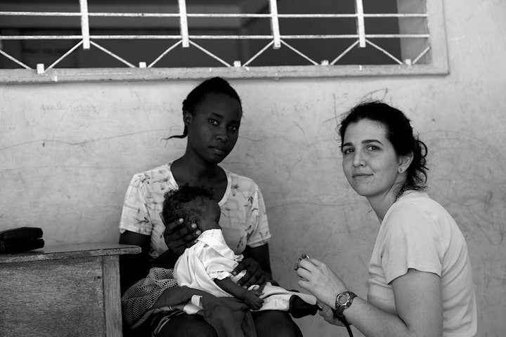 NYC Medics volunteer, Olivia Nicastro, providing medica care just days after the devastating 2010 Haiti earthquake.