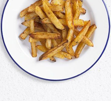 Baked skinny fries. A simple side dish of homemade chips isn't always unhealthy - this version coats the potatoes in spices too.