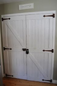 I am thinking of making the ugly sliding closet doors into faux barn door. I thing if i add faux hardware I could pull it off.