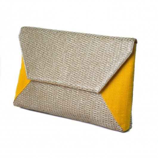 This envelope clutch made up of Woven bamboo and yellow raw silk is super versatile. It will go well with your ethnic ensembles, as well as all your chic casuals. Shop for such trendy clutch onlinle @RedPolka