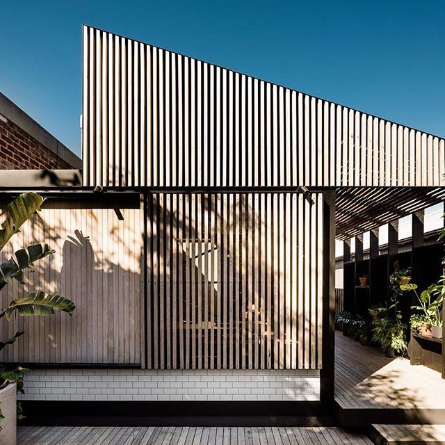 Rear Elevation of our recently completed Light Corridor House. The operable sliding timber batten screen shields the interior from the western light allowing it the facade to open up and serve as a daybed to the rear garden. Thanks again to @blachford for your amazing photography. Watch this space for more photos to come. • • • • • • #architecturevictoria #australianarchitecture #melbournearchitecture #melbournearchitects #figr #house #architecturallydesigned #designinspiration #home…