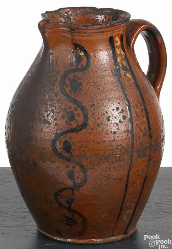 Alamance County, North Carolina redware pitcher, ca. 1800, with yellow and brown slip decoration - Price Estimate: $500 - $1000