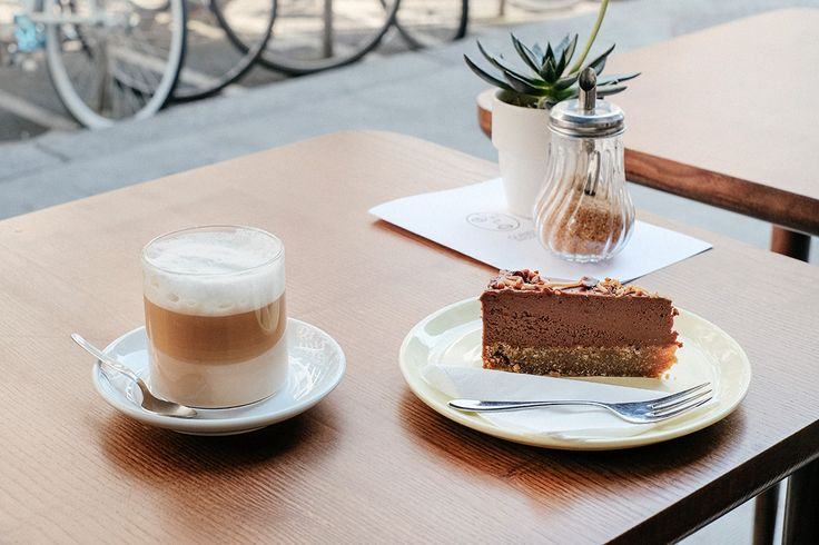 Enjoying a Café 'Renversé' and a slice of Chocolat, Noix de Cajou & Caramel Vegan on the terrace, Ou Bien Encore Geneva.