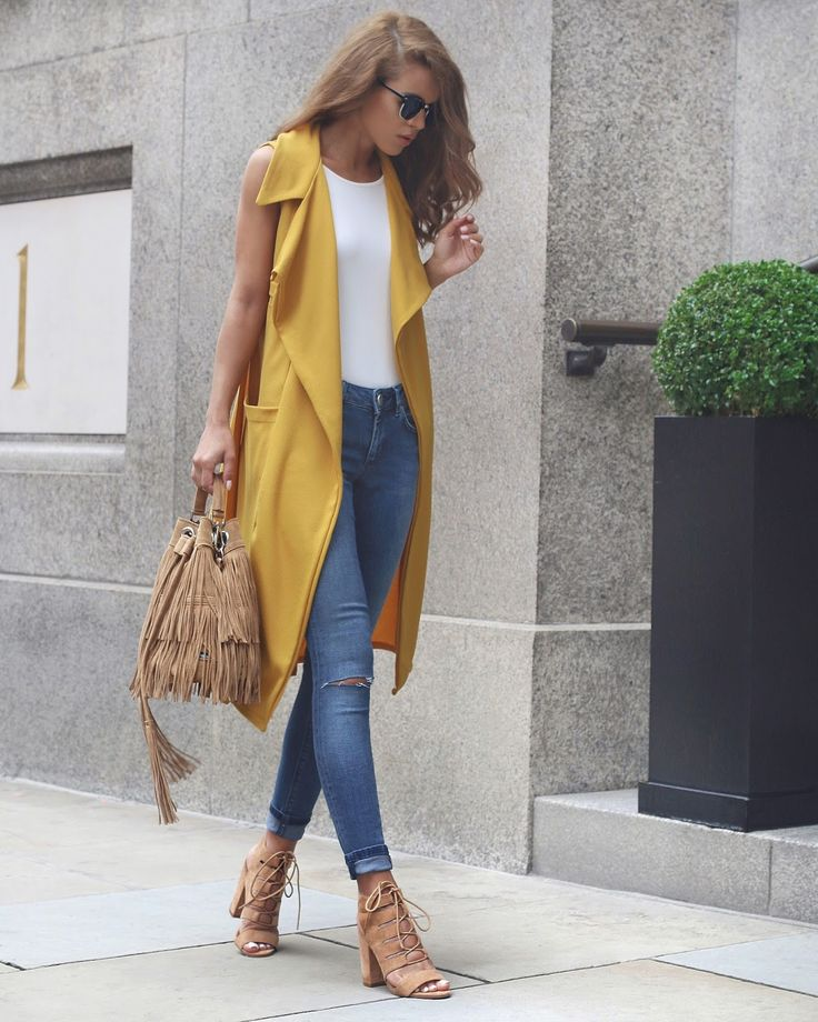 MUSTARD DUSTER [[MORE]]Sleeveless Mustard Duster - Pretty Little Thing (Here), Ribbed Bodysuit - Missguided (Here), Whitby Jeans - Asos (Here), Tassel Bag - Zatchels (Here), Lace Up Heels - Similar / (Here)Fashion By Nada Adelle