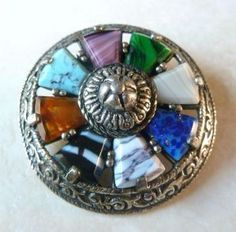 Vintage Miracle Shield Brooch With Varying Mock Gemstones.