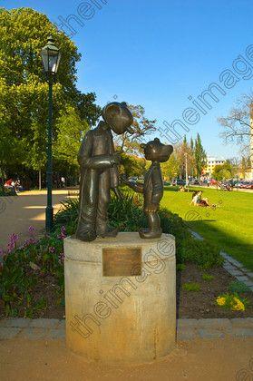 Sculpture of Spejbl and Hurvinek in Kopeckeho Sady Park Pilsen (Plzen), Czech Republic | vertical sunny statue blue sky cloudless cartoon character TIFUK858