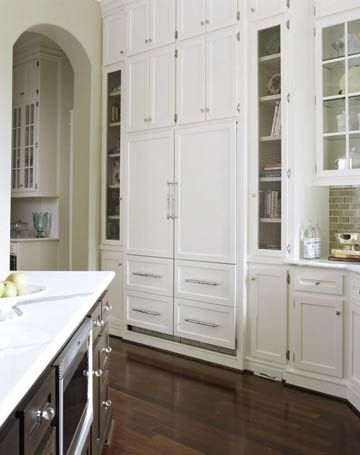 . love the hidden appliances, cabinets w/ glass. probably not in pure white. Antiquing or more earth tone helps hide little hand prints better and it wears better.