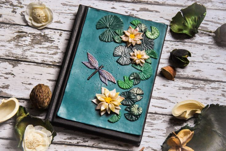 Water Lilly polymer clay notebook cover A6 size. Handmade notebook/ journal/ diary/ book. Polymer clay dragonfly. Spring floral journal by 9DaysWonderArt on Etsy https://www.etsy.com/ca/listing/502547692/water-lilly-polymer-clay-notebook-cover