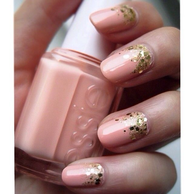 Golden glitter on peachy nails