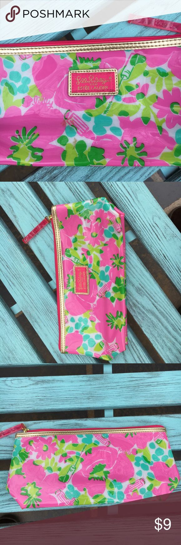 Lilly Pulitzer by Estée Lauder makeup bag Lilly Pulitzer by Estée Lauder makeup bag. Still has the plastic covering the pin pull tag! No marks and in excellent condition!! Lilly Pulitzer Bags Cosmetic Bags & Cases