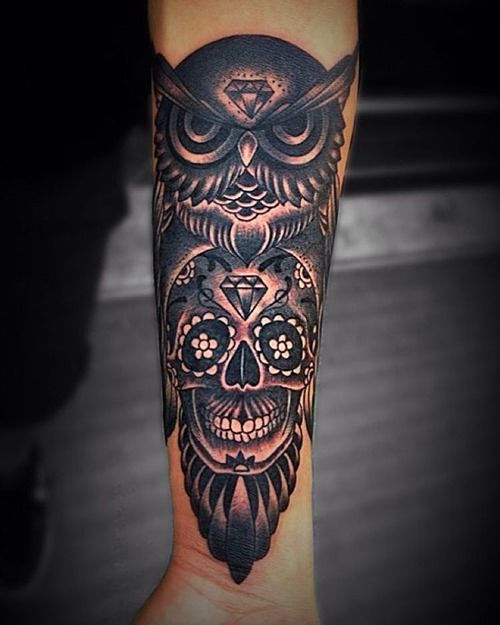 scary-owl-skull-and-diamond-arm-tattoo