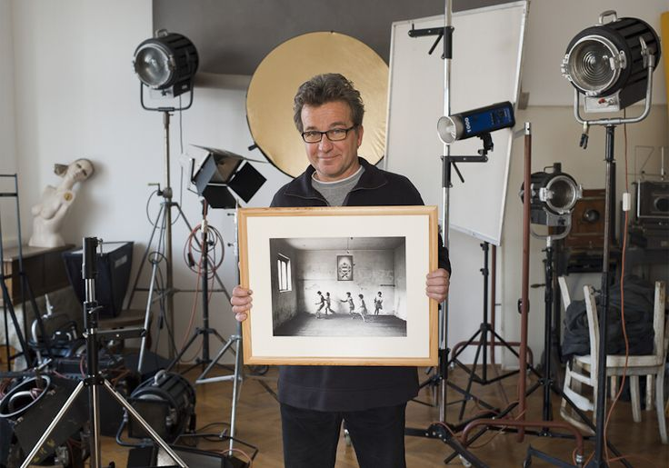 Stalter György - Famous hungarian photographers posing with their most iconic works.