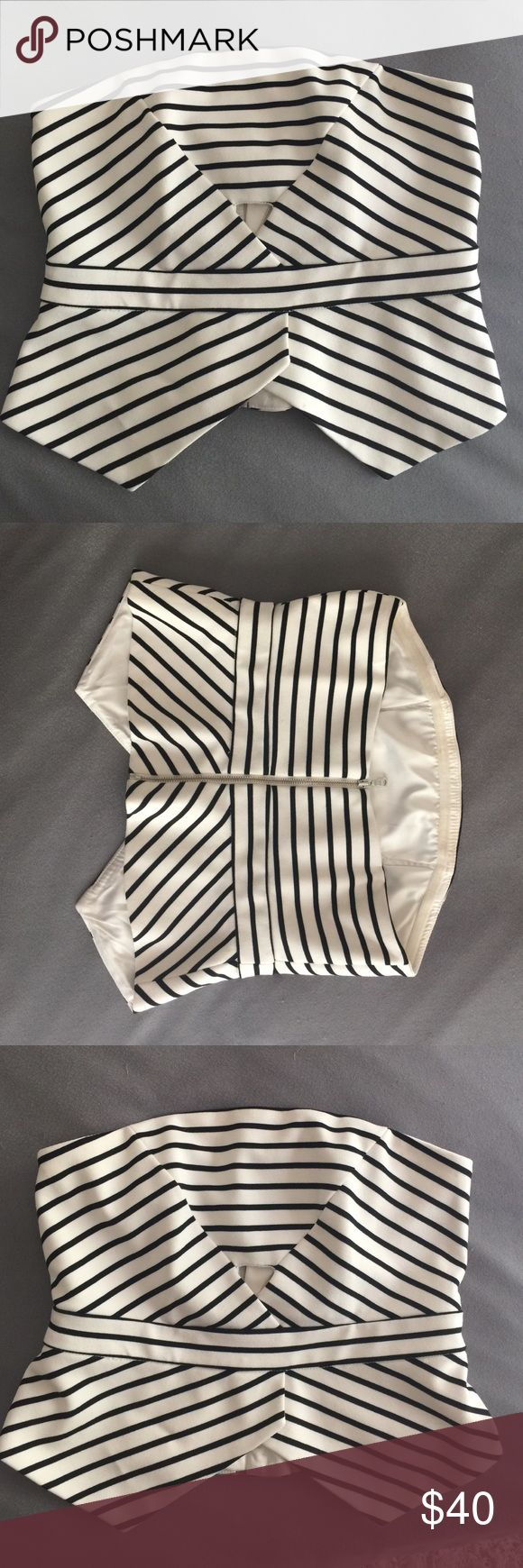Bardot strapless top White and navy blue stripped Bardot top. Has a corset type fit and is very flattering. Awesome condition. Looks great with jeans and a wedge/heel! 4/S Bardot Tops Crop Tops