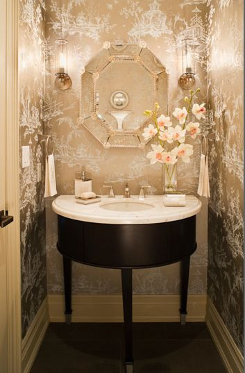 What a jewel of a powder room, eh? I imagine youd look quite beautiful in that mirror with all the golden light.