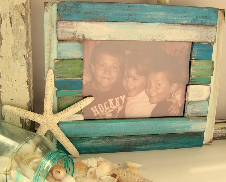 frame made from paint stirrers...really cute