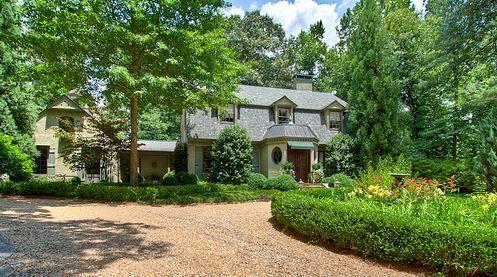 Dutch Colonial for sale in Atlanta  Love the pea gravel driveway
