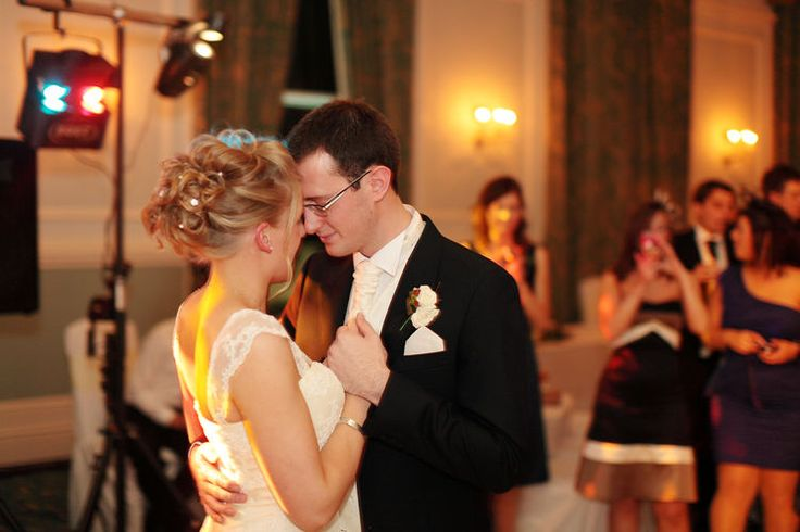 Romantic image of a bride and groom having their first dance.