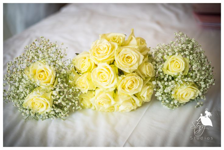Beautiful cream roses surrounded with gypsophila!