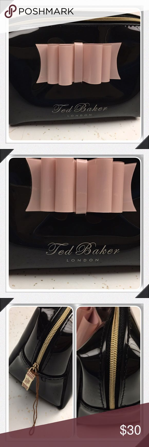 "Ted Baker Black Vinyl Pink Bow Cosmetic Wash Bag Ted Baker Black Patent w/pink bow  New without tags  Measurements: 4 1/2 H x 6 3/4"" L Ted Baker London Bags Cosmetic Bags & Cases"