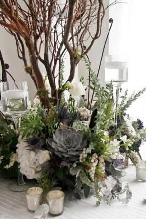 wild counrty style centrepeice with candle ...wild woodland wedding flowers