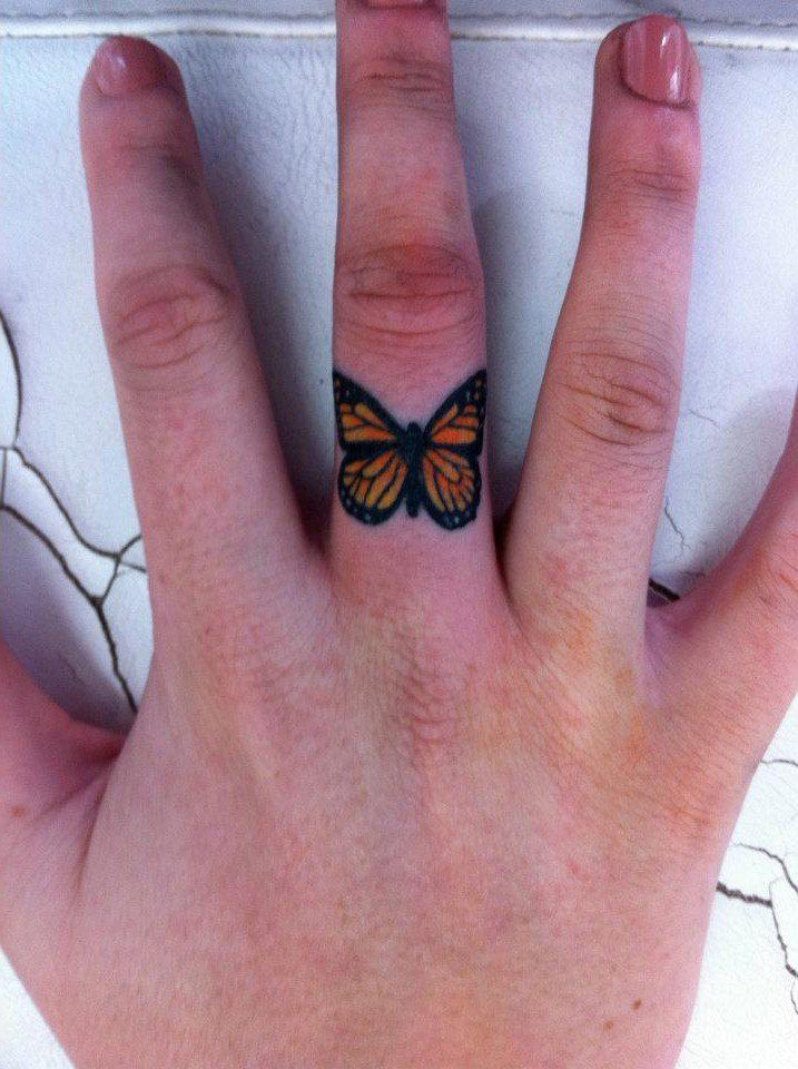 so pretty, tiny monarch butterfly tattoo on finger