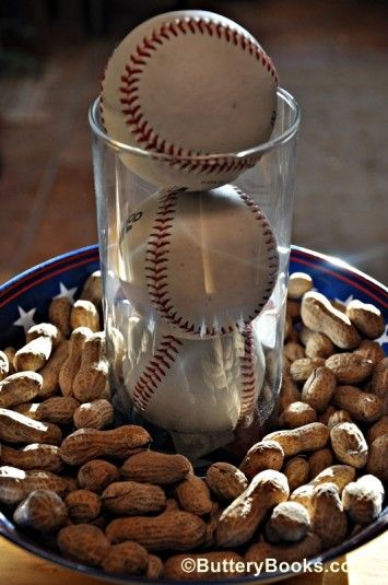 Simple baseball wedding centerpiece.  Might accent it with some candles