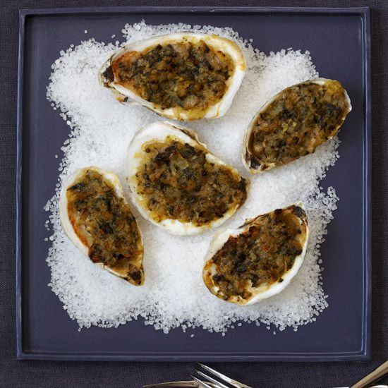 Oysters Rockefeller | This recipe is the old Delmonico restaurant's take on the classic dish, with the Rockefeller sauce base used not only to make the Oysters Rockefeller appetizer, but also used as a spread on toast to create canapés.