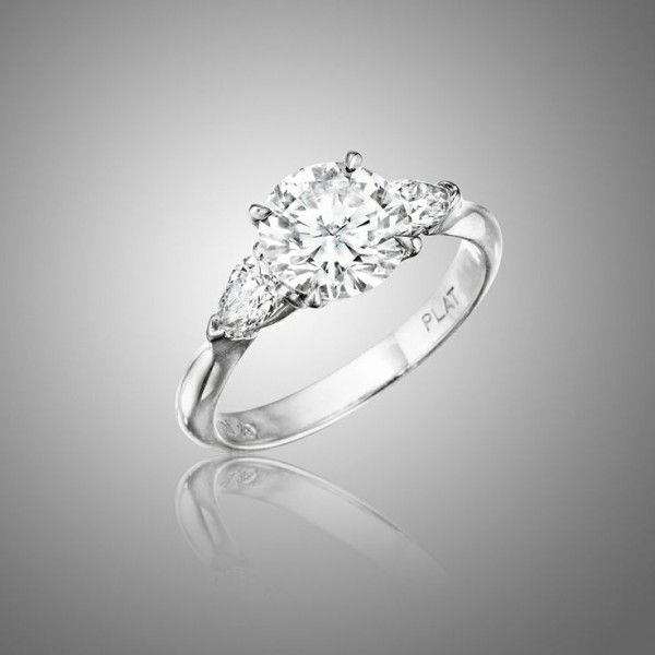 Traditional Three Stone Engagement Ring -- Definitely for me, I love the traditional style. Babe, take note. :)
