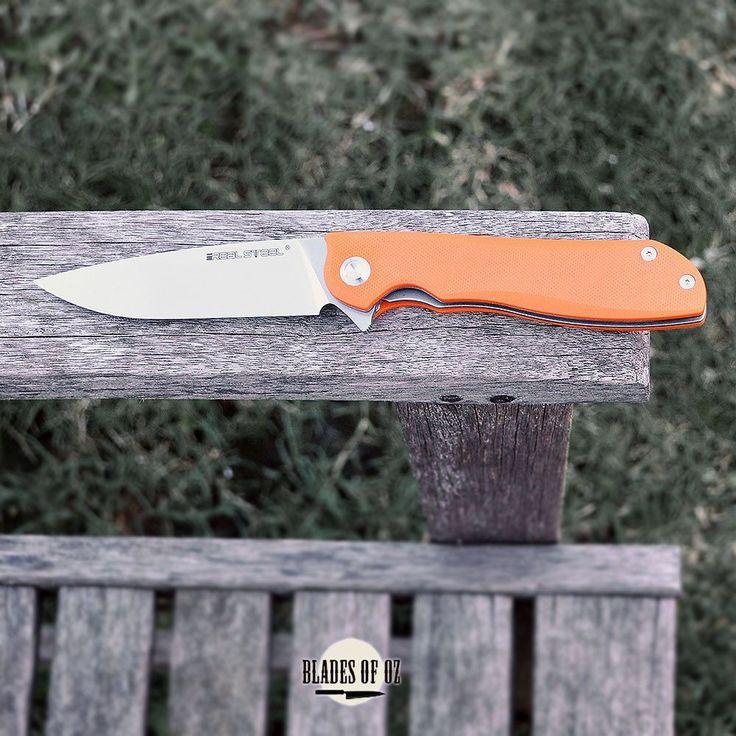 Real Steel Megalodon E801 Orange G10 Handle 14C28N Blade Flipper
