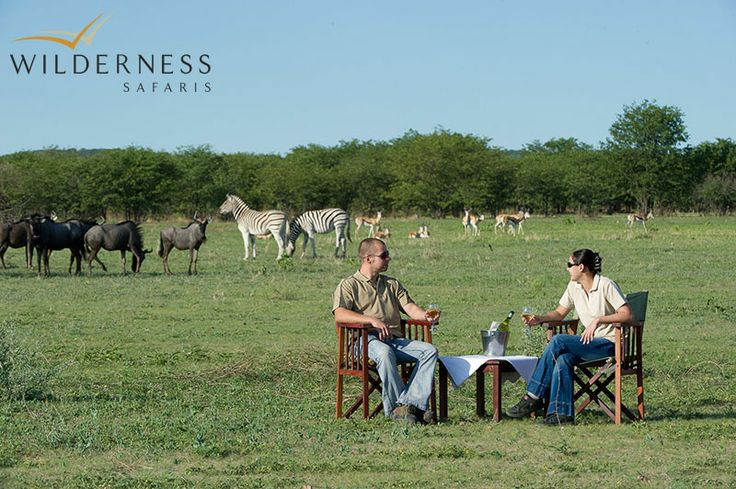 Ongava Lodge - Sip on a refreshing drink while watching wildlife having their own drinks at the waterhole #Africa #Safari #Namibia