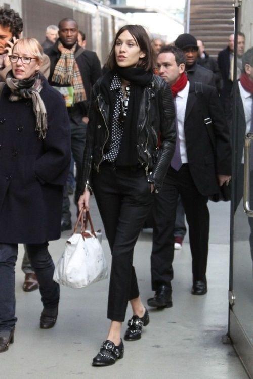 navy button up w/ white polka dots, black capri jeans, black leather jacket, flat patent black loafers, black scarf, skinny black belt, white bag