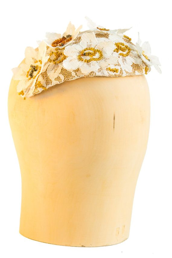 Golden sinamay covered with beige lace. Finished with lace flowers and gold/brown/grey beads. Attaches with millinery elastic. #millinery #2016
